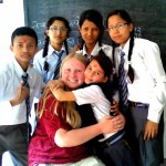 Caitlyn with some of the students