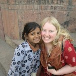 Caitlyn and Rubina, a beggar girl in India