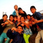 Caitlyn with Deaf students @ the soccer field in Nepal