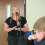 Caitlyn speaking about her trip @ FISH Club at Caldwell Middle School